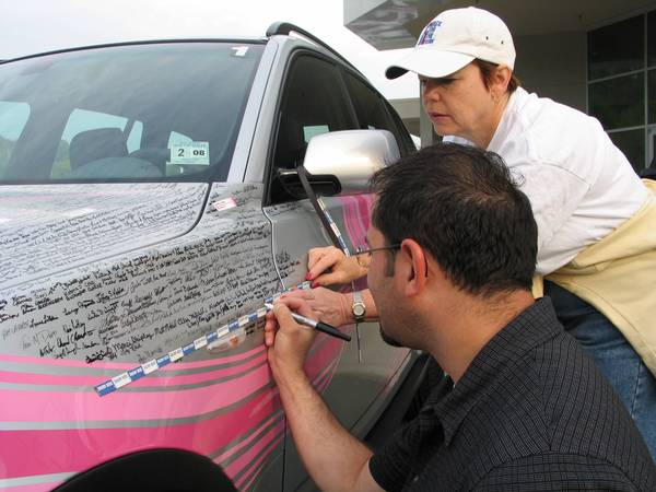 Signing the Signature Car